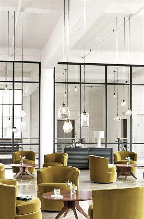 67 wall street front desk sky pendants restaurant bar armchairs and mustard