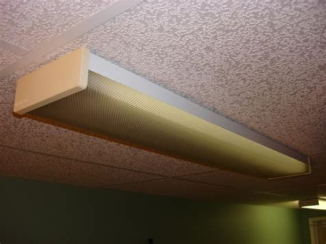 difficult to remove lens from fluorescent fixture