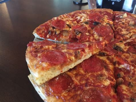 lost pizza it isn t as thin as my previous pie but i wouldn t necessarily call it a thick dough