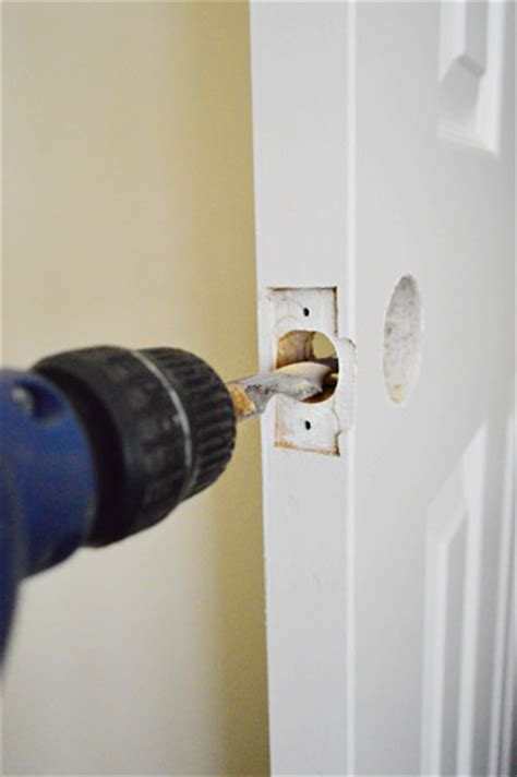 updating interior doors by installing new doorknobs