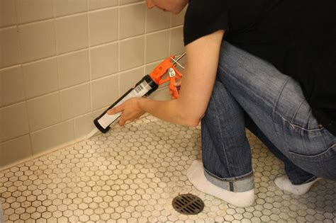 how to put caulking around a bathtub learn how to re caulk your bathroom how tos diy