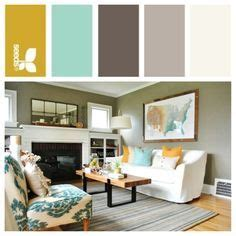 teal living room with accents of grey orange silver