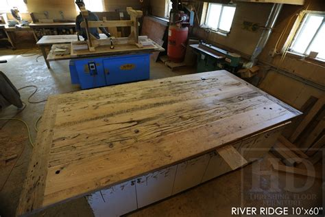 custom 10 x 60 reclaimed wood table with metal base for