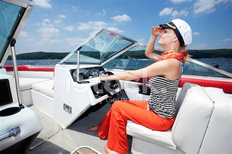 speed boat driving woman driving a speed boat stock photos freeimages