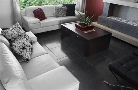 white sofa set with floral toss pillows and black floor tile designs for living room ideas