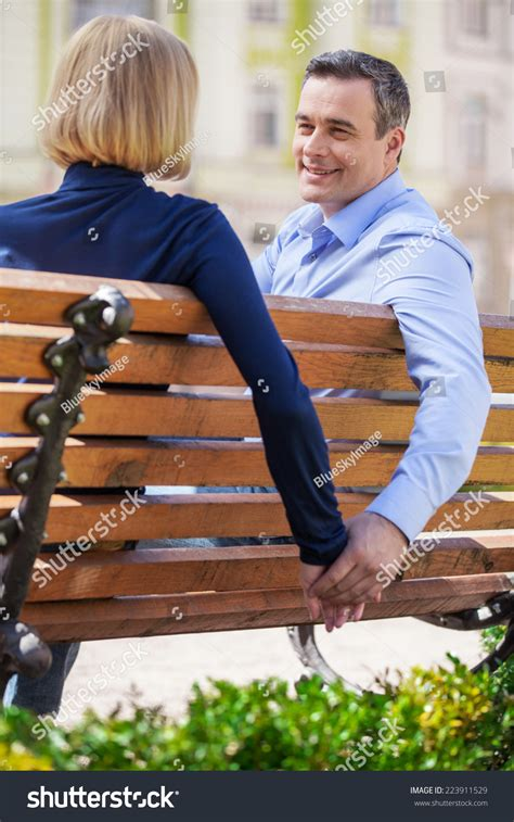 person sitting on bench two people sitting on a bench 28 images park bench stock photos images pictures