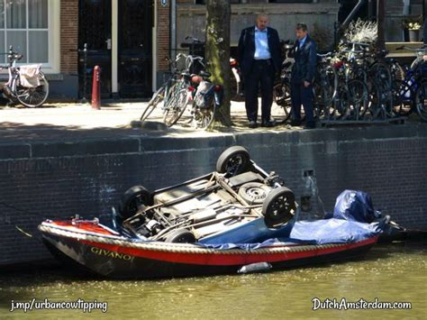 car boat race amsterdam amsterdam version of smart car tipping into the canals