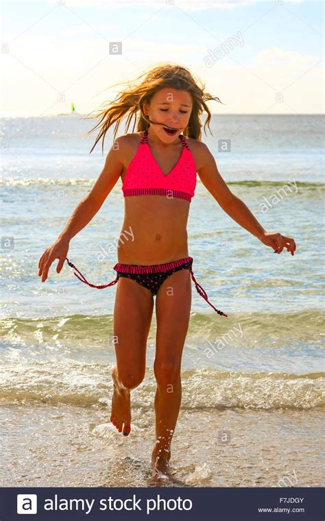 how to roller set a nine year old hair nine year old female in her bikini walks out of the gulf