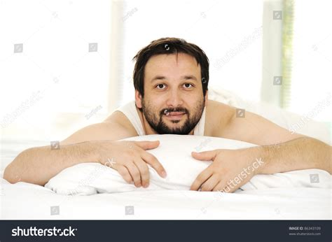 algerian men in bed man sleeping bed morning time stock photo 86343109