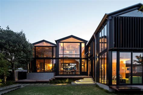 house with 3 glass gables faced with operable louvers