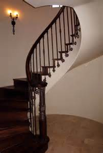 Decorating A Banister Wood Railing With Wrought Iron Balusters Traditional