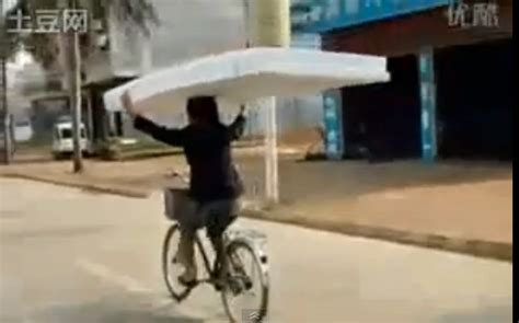 Mattress Delivered by Mattress Delivery System Involves Bicycle