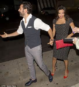 Eva longoria and boyfriend jose baston can t stop giggling during