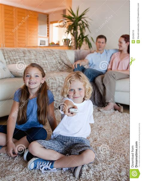 asian family watching tv together in living room this is family watching television in the living room stock photo