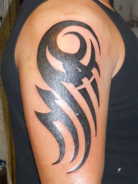 tribal tattoo in arm 50 tribal tattoos for inspirationseek