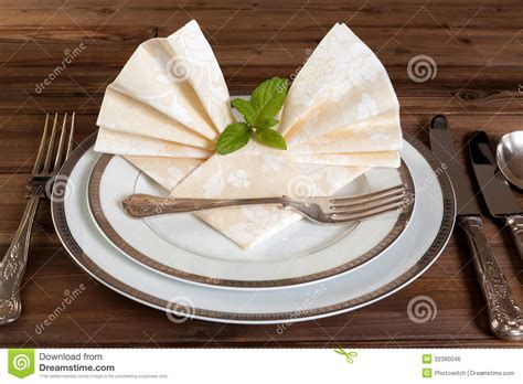 fancy place setting stock photo image of folded fancy vintage cutlery and fancy napkins stock photo image of