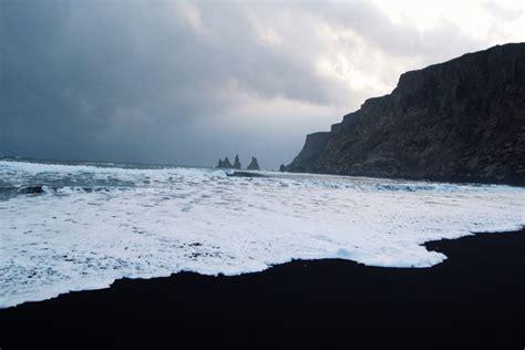 black sand beach iceland v 237 k v 237 k iceland troll rocks off the black sand beach