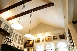 Vaulted tongue groove ceiling original wood walls