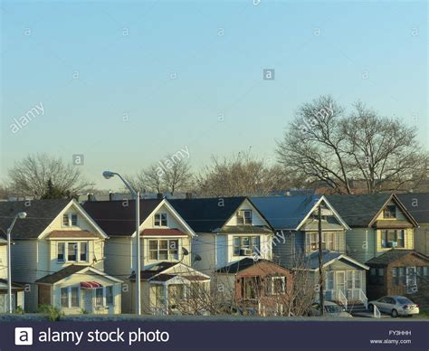 buy house in new york city new york city queens row of look alike houses stock photo royalty free image