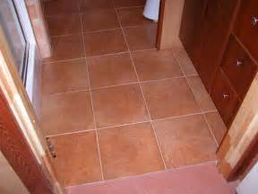 italian quot terra cotta quot style ceramic tile on floor around basin and shower stall