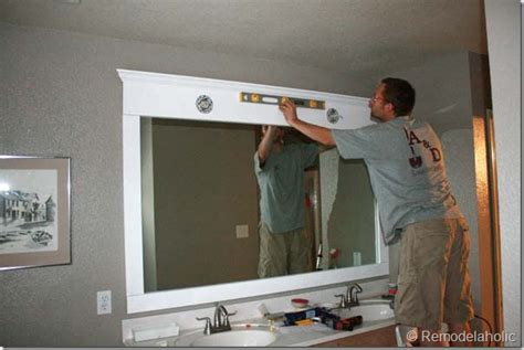 how to hang a framed bathroom mirror remodelaholic framing a large bathroom mirror