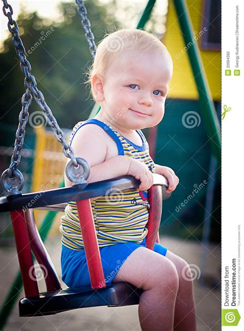 baby on a swing baby on a swing stock photography image 20994392