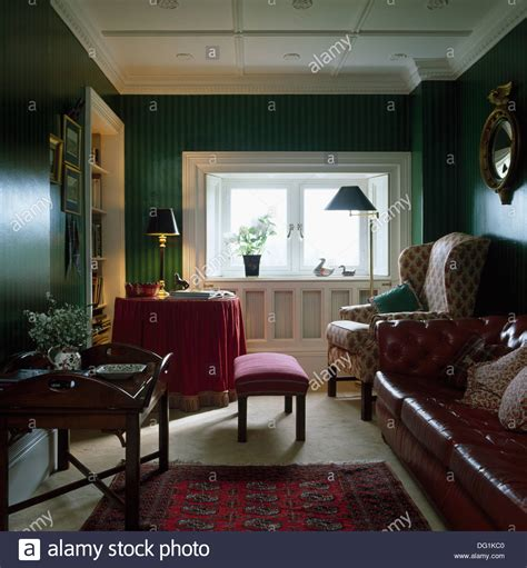 Wing Chair And Brown Leather Sofa In Dark Green Living Green Chairs For Living Room