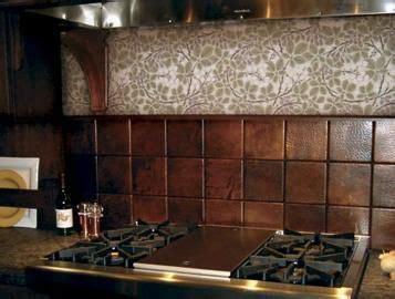 hand hammered copper tile backsplash   ..not the