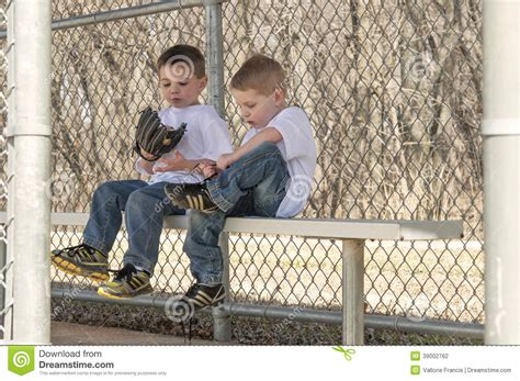 boys bench two boys sitting on the bench stock photo image 39002762