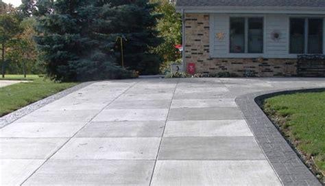 concrete driveway and paver driveway stuart lawn and land