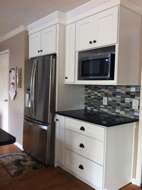 tv above refrigerator kitchen ideas pinterest microwave shelf dark quartz with white cabinets