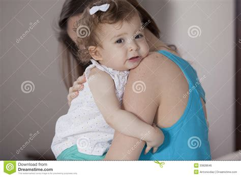 how to comfort baby mom comforting her baby girl stock photo image of sitter