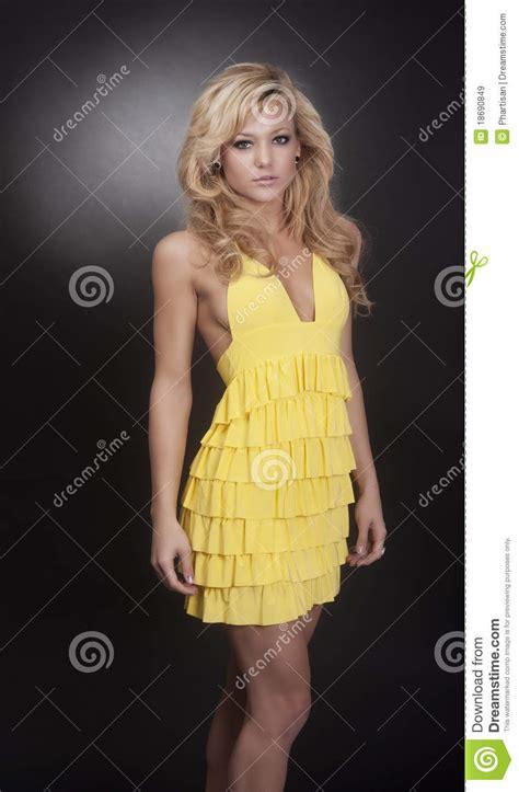blond fashion model wearing yellow dress royalty  stock images image
