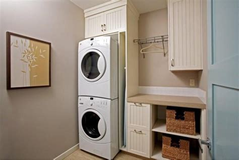 Hanging Laundry Room Cabinets Stacked Washer Dryer Storage Built In With Custom Wooden Cabinet With Door Table Hanging Rod And