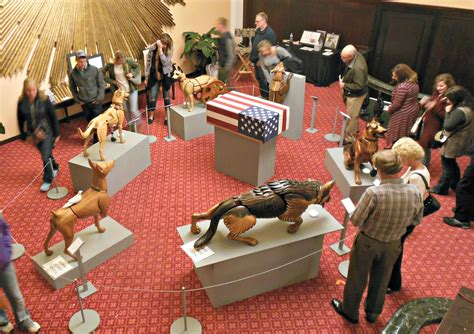 dogs for wounded warriors wooden carvings of wounded warrior dogs wins vote in artprize 2016
