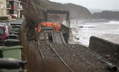 storms wash uk rail line into sea cutting off western