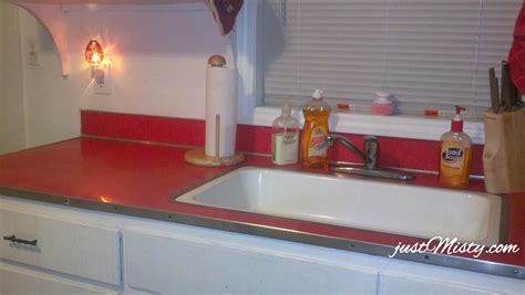 How To Paint Your Kitchen Cabinets White by Redo Your Ugly Laminate Countertops For Under 10 With