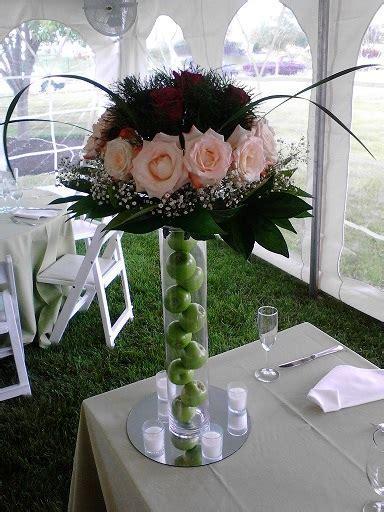 Fresh flower arrangements on a tall vase  Raji Creations