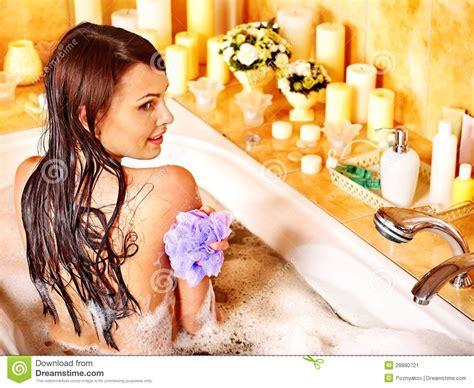 woman bathtub woman using bath sponge in bathtub stock image image