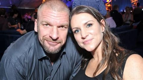 stephanie mcmahon asks triple h to sign the annulment triple h and stephanie mcmahon at super bowl xlix wwe