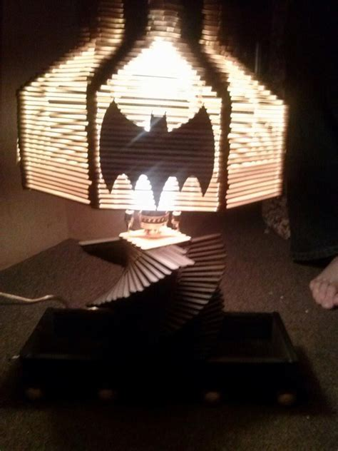 Made a batman lamp for a friend out of Popsicle sticks