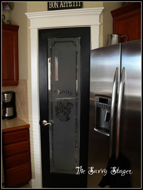 Black Glass Kitchen Doors by Black Door The Savvy Stager