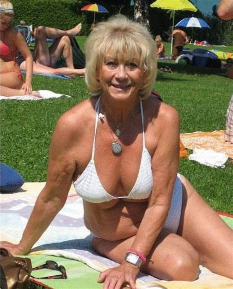 granny pubic hair blond mature woman in white bra sitting on blanket in