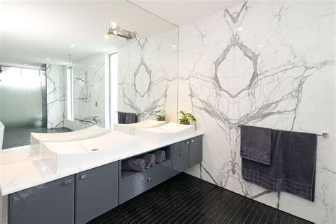 stone bathroom wall panels robel bookmatched statuario marble wall we re a big fan