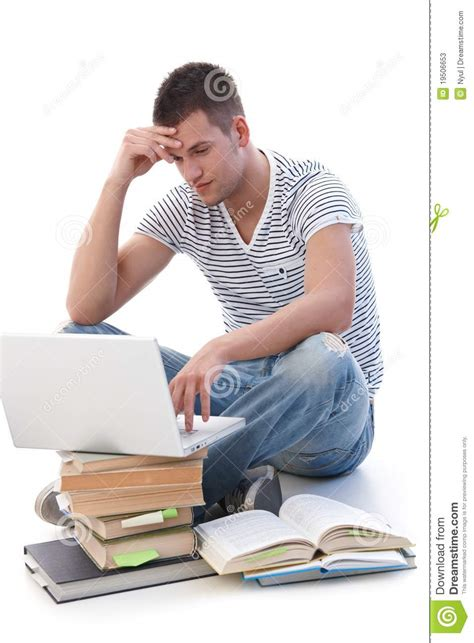 Homework College Time by College Student Doing Homework On Laptop Stock Photos