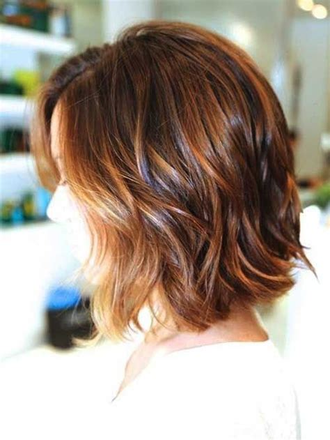 medium length hair style low lights back view of short wavy haircut with nice high and low