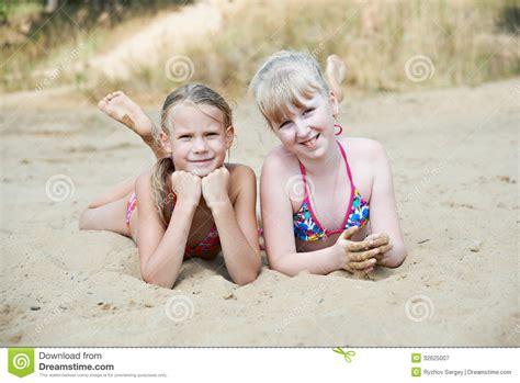 little girl models beach happy little girls on sand beach royalty free stock