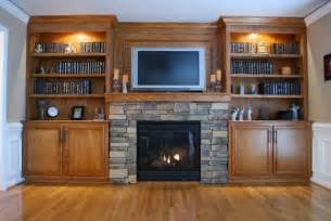 fireplace with built in cabinets custom built in cabinets and surround fireplace