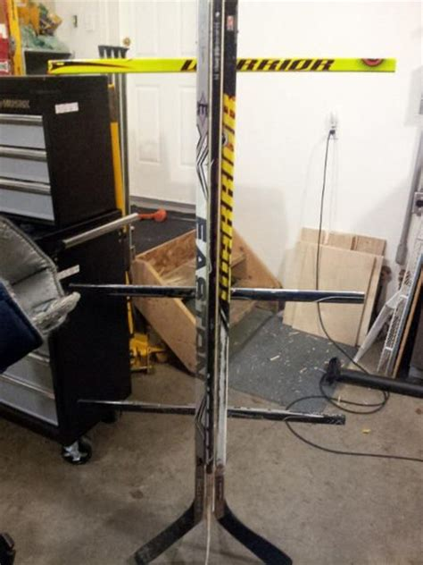 Hockey Equipment Storage Rack by Equipment Rack Made Of Hockey Sticks Organize Hockey