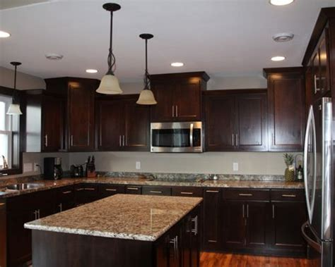 staggered kitchen cabinets staggered kitchen cabinets ideas pictures remodel and decor